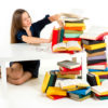 girl don't want to study and learn she is pushing away from herself a stack of books